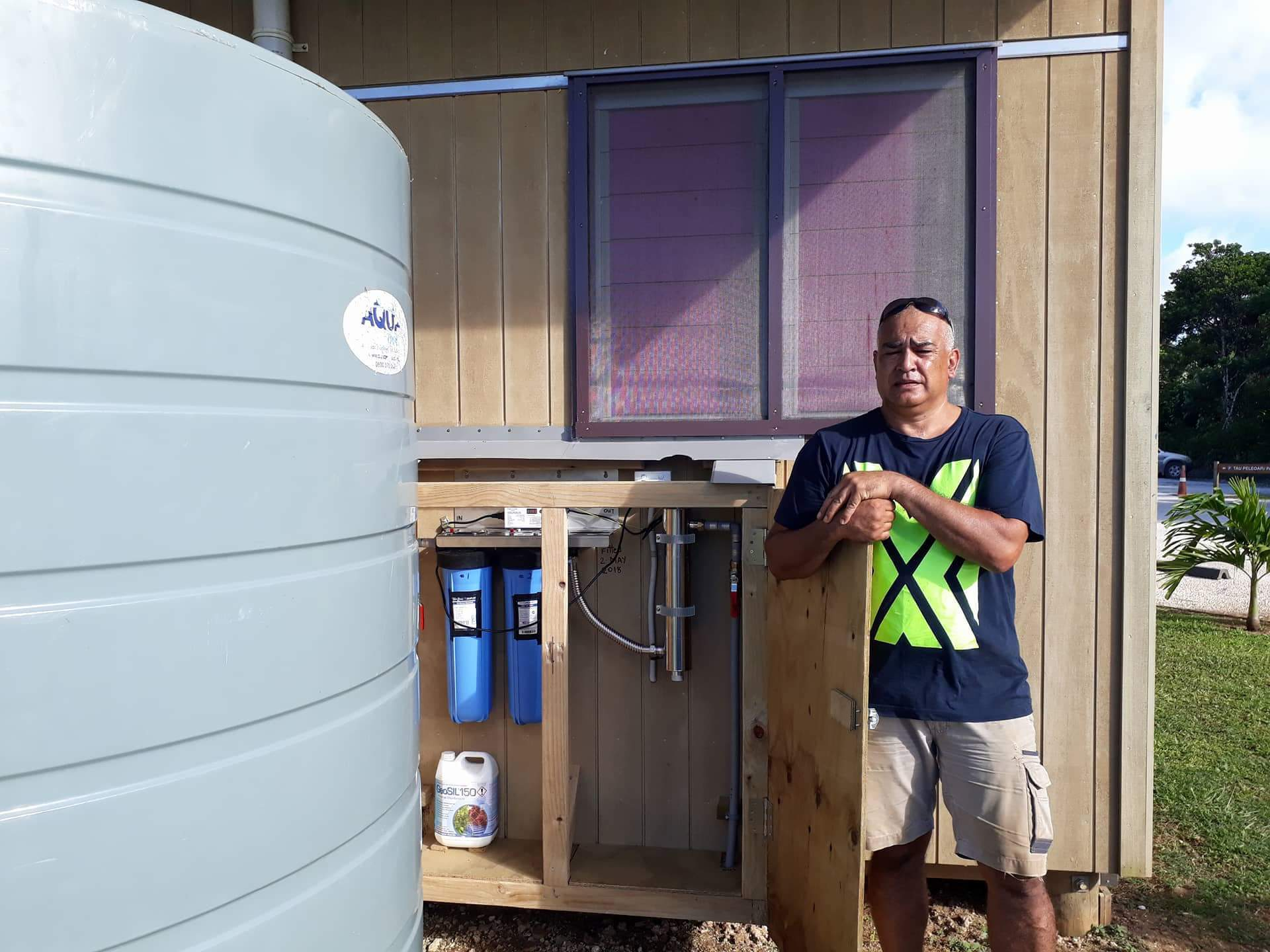 Charlie Roughan installing Niue Primary School new UV Water Treatment